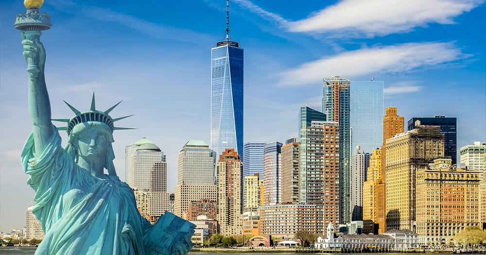 New York City - The Statue of Liberty in front of the skyline of New York