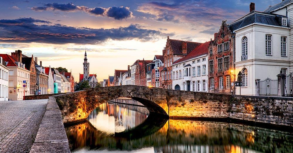 Bruges - Old town with picturesque bridge in the evening light